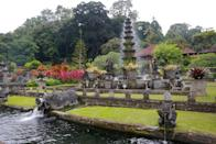 """<p><strong>What's the story behind this place?</strong><br> Although Tirta Gangga ($2 entry), a former palace turned lavish water gardens, looks like it has existed for several centuries, it was actually conceived in 1946 by the royal Karangasem family. But its far out east Bali location hasn't stopped travelers from exploring its magical fountains, shrubs, sculptures, and flowers, or positioning themselves on the octagonal stepping stones and feeding the carp. There are also stone spring water pools and you can swim in one of them.</p> <p><strong>What's the vibe like in the garden?</strong><br> This feels like an enchanted water theme park, one that's sure to stir your inner child.</p> <p><strong>Do you need a guide?</strong><br> Driver-guides can pick you up from your hotel, whisk you to the gardens, and pinpoint the best areas to explore.</p> <p><strong>Who comes here?</strong><br> Committed travelers who take the two- to three-hour drive to explore eastern Bali.</p> <p><strong>So is it worth the lengthy drive?</strong><br> The Tirta Gangga is a Balinese fantasyland—colorful blooms, tiered fountains, mythical statuettes, and ponds, all with the imposing <a href=""""https://www.cntraveler.com/story/bali-mount-agung-eruption-leads-to-flight-cancellations?mbid=synd_yahoo_rss"""" rel=""""nofollow noopener"""" target=""""_blank"""" data-ylk=""""slk:Mount Agung"""" class=""""link rapid-noclick-resp"""">Mount Agung</a> in the backdrop. It's definitely a mood-lifter.</p> <p><strong>Why recommend it to a visitor to Bali?</strong><br> These gardens are a top choice for anyone who enjoy beautiful, imaginative landscapes. It's at least two hours away from Ubud and Bali's southern beach towns—the remote location is part of the allure—still, aim to arrive early in the morning to beat the crowds.</p>"""