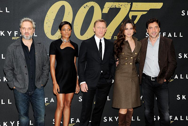 """Director Sam Mendes, left, poses with actors Naomie Harris, Daniel Craig, Berenice Marlohe and Javier Bardem during a photo call for the new James Bond film """"Skyfall"""" at the Crosby Street Hotel on Monday Oct. 15, 2012 in New York. (Photo by Evan Agostini/Invision/AP)"""