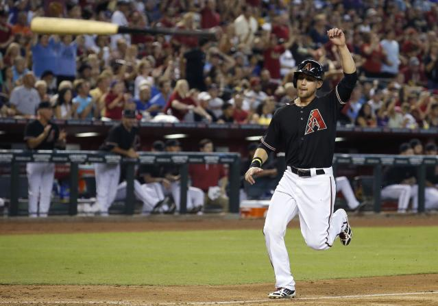 As teammate Miguel Montero's bat goes flying into the air, Arizona Diamondbacks' Ender Inciarte raises his arm in celebration as he comes in to score a run on a 3-run double by Montero against the Chicago Cubs during the fifth inning of a baseball game on Saturday, July 19, 2014, in Phoenix. (AP Photo/Ross D. Franklin)