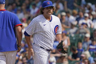 Chicago Cubs relief pitcher Andrew Chafin, right, walks to the dugout after turning the ball over to manager David Ross during the seventh inning of a baseball game against the Arizona Diamondbacks in Chicago, Saturday, July 24, 2021. (AP Photo/Nam Y. Huh)