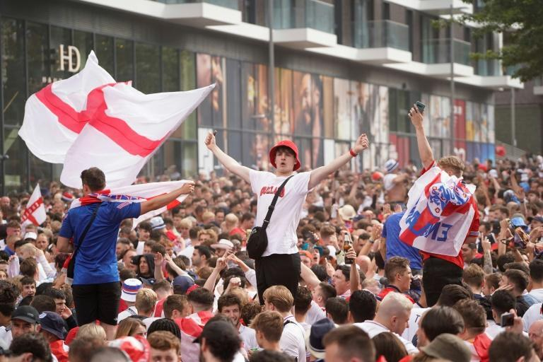 Fans gather outside Wembley Stadium ahead of the Euro 2020 final