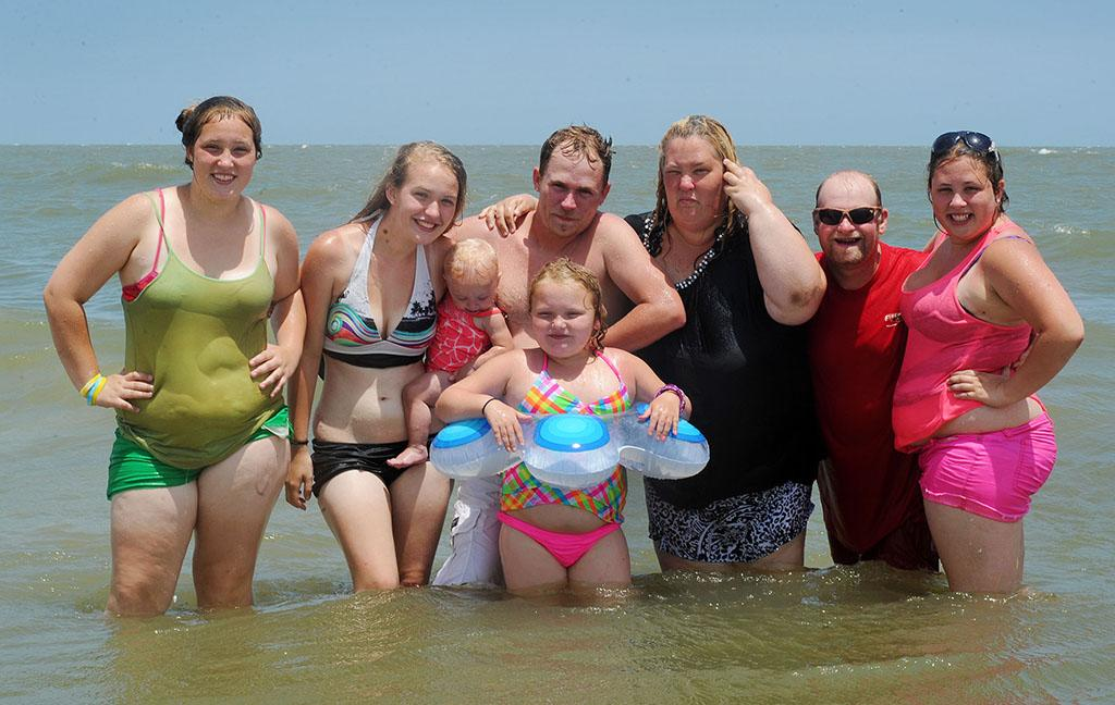 "EXCLUSIVE: **NO WEB Until 1PM PSt** Honey Boo Boo and family hit the beach in Tybee Island, Georgia. The reality family had a few days off from filming their hit TV show 'Here Comes Honey Boo Boo'. Mama June was getting knocked over by the waves and Sugar Bear and their security guard had to go into the water to stand her up. Honey Boo Boo Alana had a blast with a tube tied around her waist while she went for a swim with her Dad Sugar Bear. The sisters buried Uncle Poodle into the sand and also Pumpkin.   Pictured: ""Mama"" June Shannon  Ref: SPL560550 120613  EXCLUSIVE  Picture by: Jason Winslow / Splash News     Splash News and Pictures  Los Angeles:	310-821-2666  New York:	212-619-2666  London:	870-934-2666  photodesk@splashnews.com"