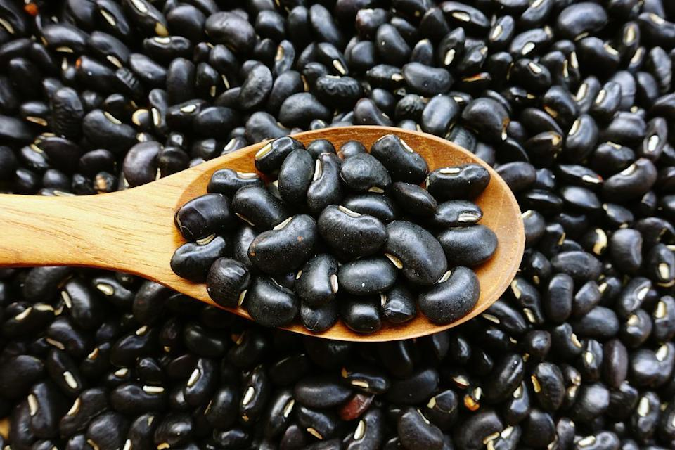 """<p>With a sweet taste, soft texture and matte color, black beans are medium-sized and take an hour or 90 minutes to cook. They can be pureed and coated over tortas, blended into berry smoothies or rinsed, drained and mixed into chilis, <a href=""""https://www.thedailymeal.com/recipes/15-minute-quinoa-burrito-bowls-recipe?referrer=yahoo&category=beauty_food&include_utm=1&utm_medium=referral&utm_source=yahoo&utm_campaign=feed"""" rel=""""nofollow noopener"""" target=""""_blank"""" data-ylk=""""slk:burrito bowls"""" class=""""link rapid-noclick-resp"""">burrito bowls</a>, soups and salsas.</p>"""