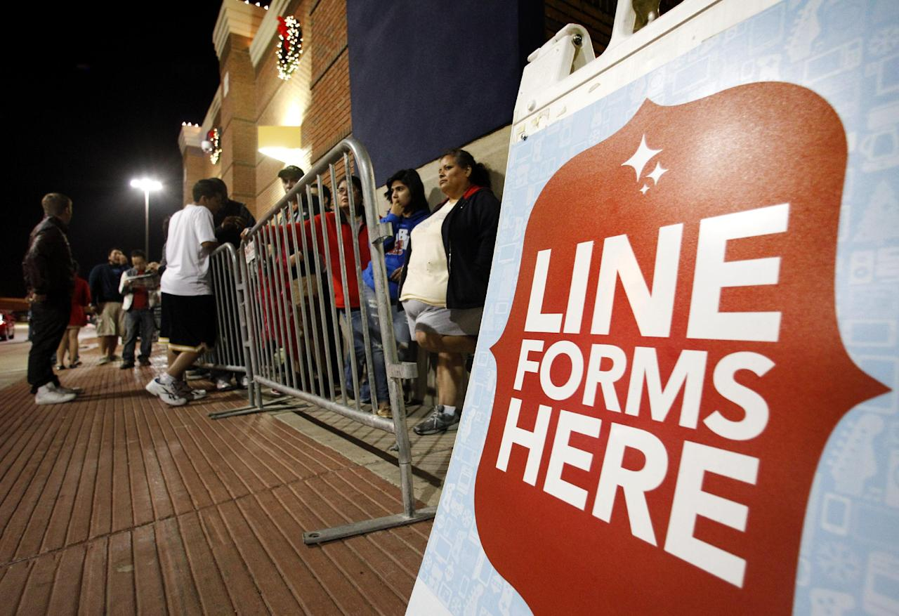 Shoppers line up outside a Best Buy department store waiting for it to be opened at midnight for Black Friday sales Thursday, Nov. 22, 2012, in Arlington, Texas. (AP Photo/Tony Gutierrez)