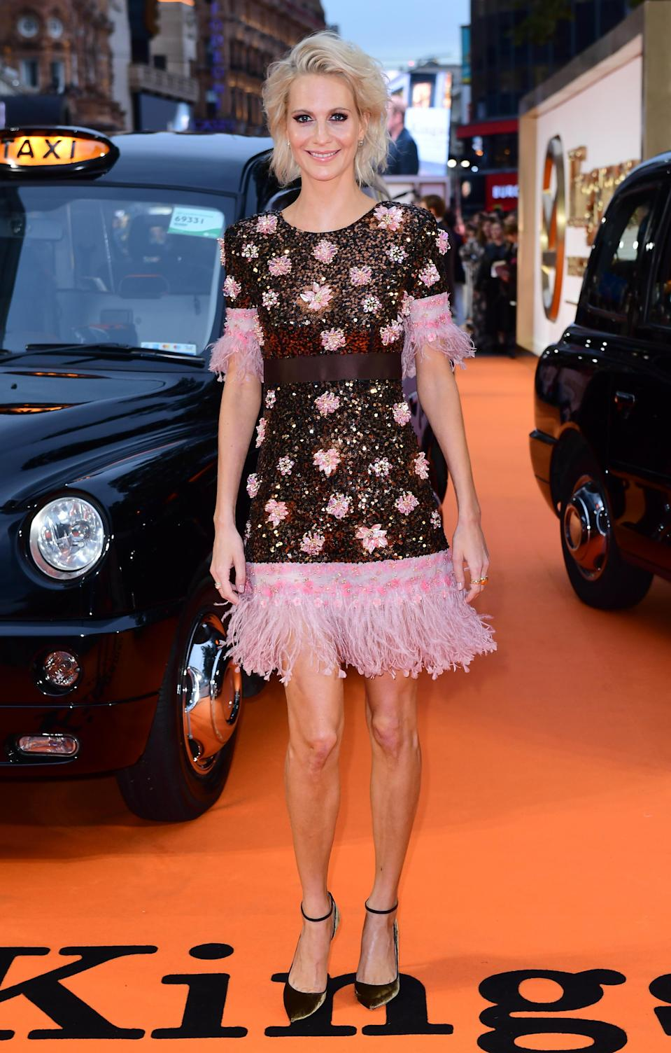 <p>Poppy showed off a new shorter hairstyle in a 1920s-style beaded Chanel dress complete with pink fringing on the hem.<br><i>[Photo: PA]</i> </p>