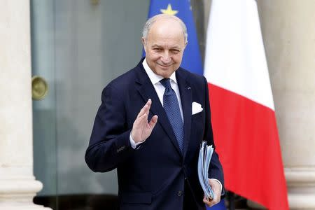 French Foreign Minister Laurent Fabius leaves after the weekly cabinet meeting at the Elysee Palace in Paris