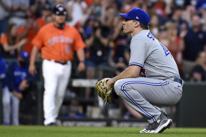 Toronto Blue Jays starting pitcher Ross Stripling reacts after walking Houston Astros' Alex Bregman with the bases loaded during the second inning of baseball game, Friday, May 7, 2021, in Houston. (AP Photo/Eric Christian Smith)