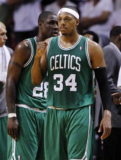 Boston Celtics' Paul Pierce (34) pumps his fist after a call was reversed to give the Celtics possession of the ball in the closing minutes of the fourth quarter in Game 5 of their NBA basketball Eastern Conference finals playoff series against the Miami Heat, Tuesday, June 5, 2012, in Miami. The Celtics won 94-90. (AP Photo/Lynne Sladky)