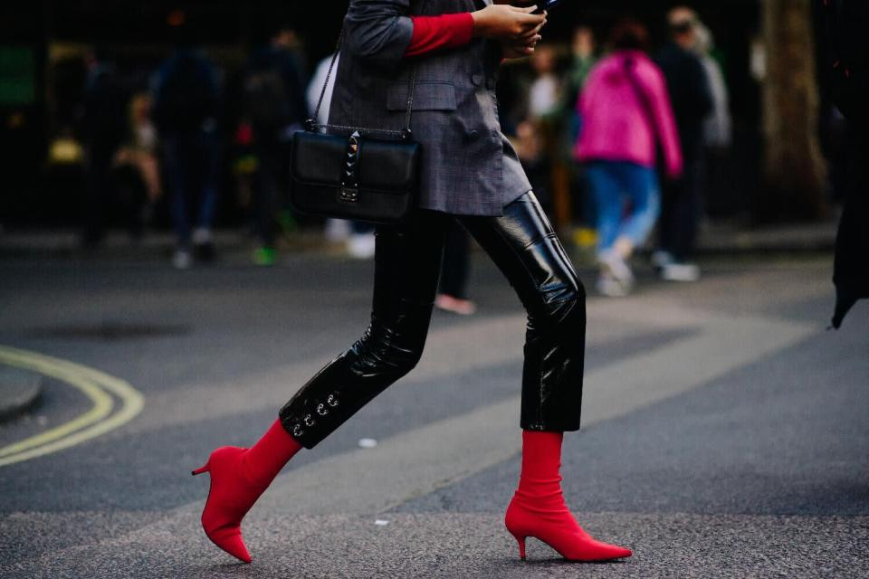 <p>The colour red has been on the rise for a while, however not all of us are brave enough to don the bright hue head-to-toe, making a statement pair of ankle boots the perfect compromise. <em>[Photo: Katz Sinding]</em> </p>