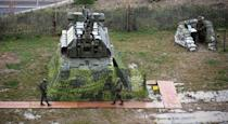 Russian soldiers patrol the air defence missile base stationed near the Olympic park at the Black Sea resort city of Sochi, on November 30, 2013