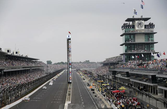 Jeff Gordon drives into Turn 1 during the Brickyard 400 auto race at Indianapolis Motor Speedway in Indianapolis, Sunday, July 27, 2014. (AP Photo/AJ Mast)