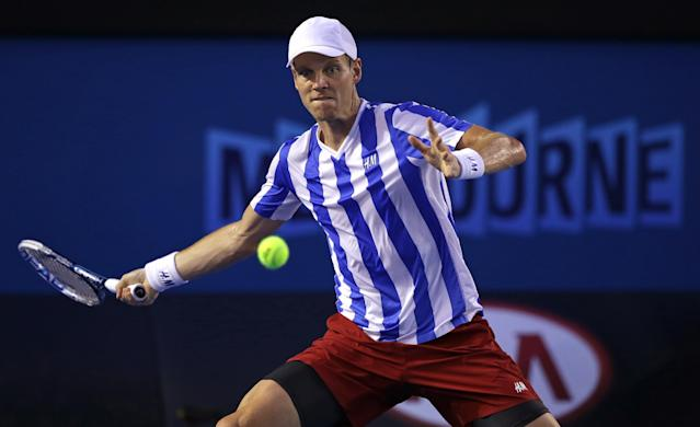 Tomas Berdych of the Czech Republic makes a forehand return to Stanislas Wawrinka of Switzerland during their semifinal at the Australian Open tennis championship in Melbourne, Australia, Thursday, Jan. 23, 2014.(AP Photo/Aaron Favila)