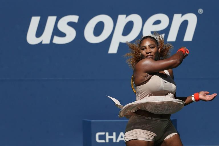 Serena Williams of the United States returns the ball during her fourth round match against Maria Sakkari of Greece at the US Open