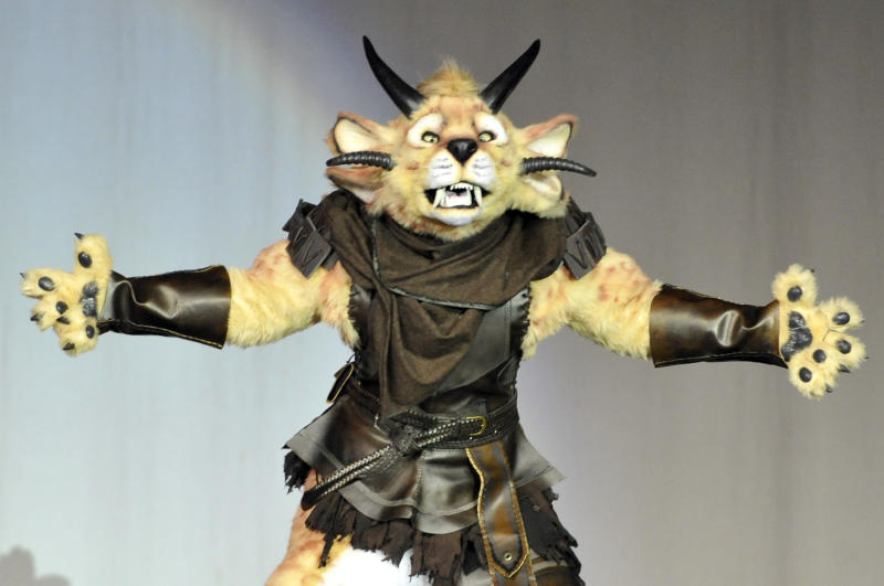 Devon Jopling shows off his Charr costume in a skit at the 2013 Comic-Con International Masquerade on Wednesday, July 20, 2013 in San Diego. (Photo by Jack Dempsey/Invision/AP)