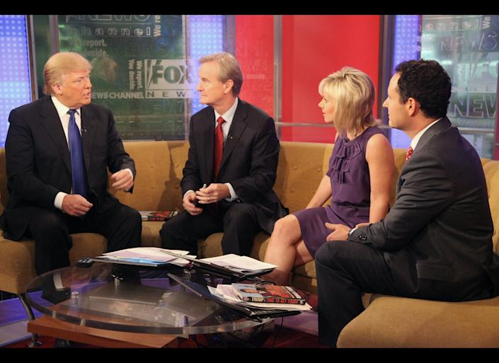 NEW YORK, NY - DECEMBER 06: (L-R) Donald Trump talks with 'FOX & Friends' hosts Steve Doocy, Gretchen Carlson and Brian Kilmeade at FOX Studios on December 6, 2011 in New York City. (Photo by Astrid Stawiarz/Getty Images)