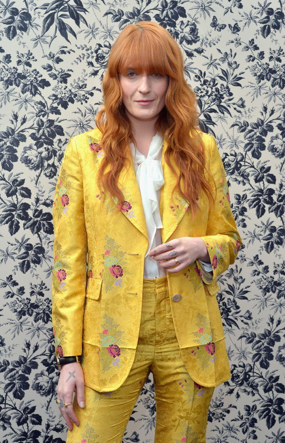 <p>Queen of romantic boho, Florence Welch, works her copper hair with a bold block fringe.</p>
