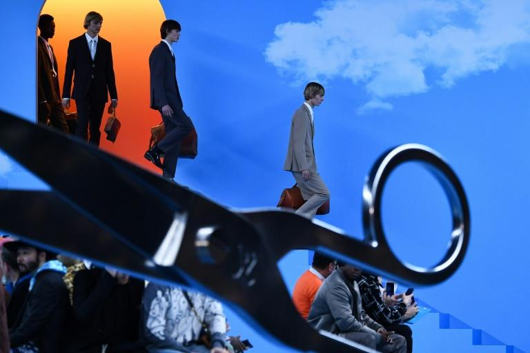 Stairway from heaven: Models in suits at the Louis Vuitton Paris men's fashion week show (AFP Photo/Anne-Christine POUJOULAT)