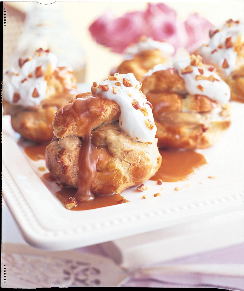"""These super-seasonal cream puffs are stuffed with a silky pumpkin custard and topped with rich bourbon caramel, whipped cream, and chopped pecans. <a href=""""https://www.epicurious.com/recipes/food/views/pumpkin-custard-profiteroles-with-maple-caramel-231118?mbid=synd_yahoo_rss"""" rel=""""nofollow noopener"""" target=""""_blank"""" data-ylk=""""slk:See recipe."""" class=""""link rapid-noclick-resp"""">See recipe.</a>"""