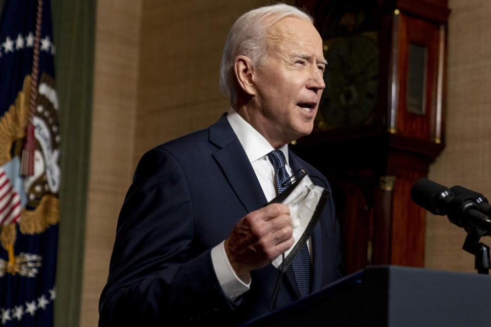 President Joe Biden removes his mask to speak from the Treaty Room in the White House on Wednesday, April 14, 2021, about the withdrawal of the remainder of U.S. troops from Afghanistan. (AP Photo/Andrew Harnik, Pool)