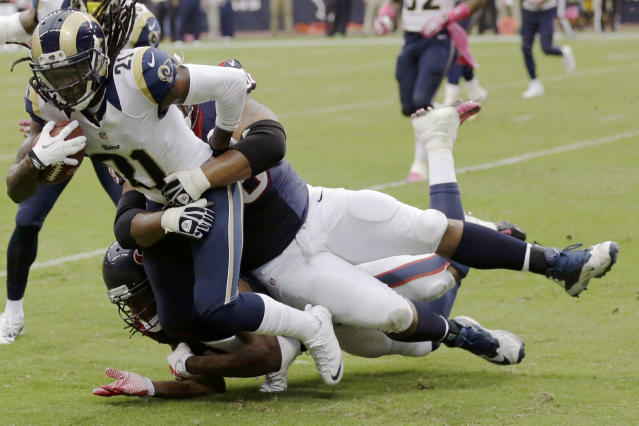 St. Louis Rams cornerback Janoris Jenkins (21) is tackled by Houston Texans tackle Ryan Harris after intercepting a pass by the Texans' T.J. Yates during the fourth quarter of an NFL football game Sunday, Oct. 13, 2013, in Houston, Texas. (AP Photo/Eric Gay)