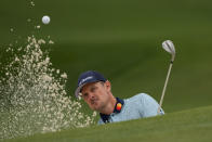 Justin Rose, of England, hits out of a bunker on the seventh hole during the second round of the Masters golf tournament on Friday, April 9, 2021, in Augusta, Ga. (AP Photo/Gregory Bull)