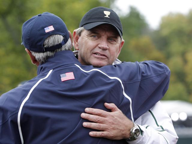International team captain Nick Price, right, and United States team captain Fred Couples hug after the U.S. won the Presidents Cup golf tournament at Muirfield Village Golf Club Sunday, Oct. 6, 2013, in Dublin, Ohio. (AP Photo/Jay LaPrete)