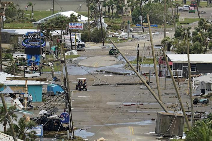 The remains of destroyed homes and businesses are seen in the aftermath of Hurricane Ida in Grand Isle, La., Tuesday, Aug. 31, 2021. (AP Photo/Gerald Herbert)