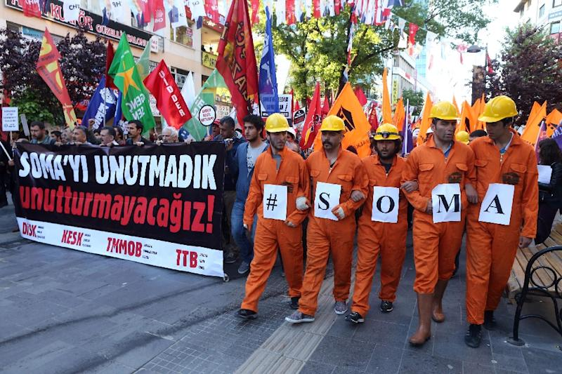 """Turkish union members hold a banner reading """"We will not forget Soma"""" at a 2015 march in Ankara in memory of the 301 people killed the previous year in a mining disaster"""