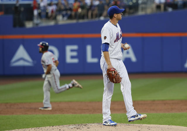 New York Mets starting pitcher Steven Matz stands on the mount after giving up a solo home run to Washington Nationals' Anthony Rendon during the third inning of a baseball game Thursday, July 12, 2018, in New York.(AP Photo/Julie Jacobson)