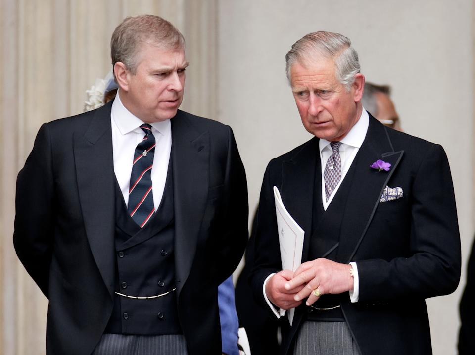 Prince Andrew and Prince Charles talking