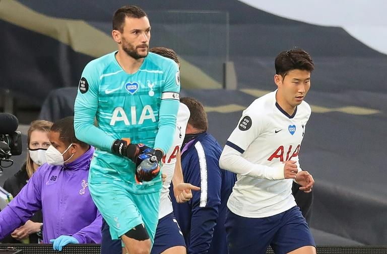 Fighting spirit: Hugo Lloris (left) and Son Heung-min (right) had to be separated by teammates in Tottenham's clash with Everton