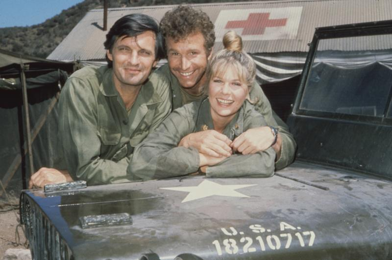 Alda is seen with fellow actors Wayne Rogers, as Captain Trapper John McIntyre, and Loretta Swit, as Major Margaret Houlihan, on the television series 'M*A*S*H' in 1972. (CBS Photo Archive via Getty Images)
