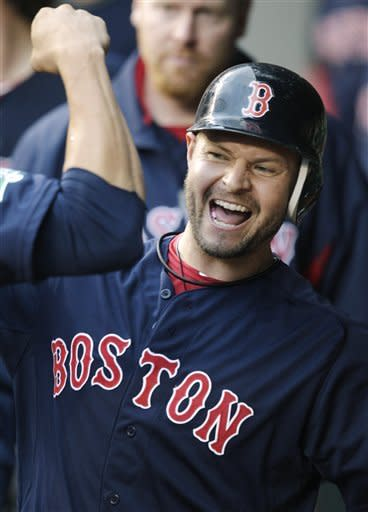 Boston Red Sox's Cody Ross celebrates after hitting a solo home run against the Seattle Mariners in the fifth inning of a baseball game, Friday, June 29, 2012, in Seattle. (AP Photo/Ted S. Warren)