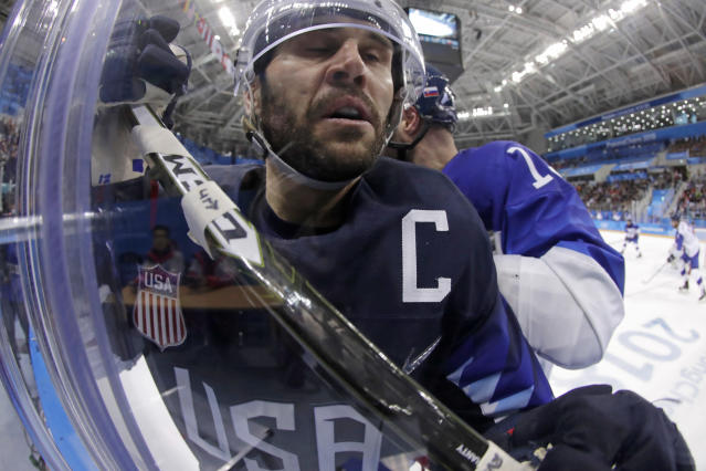 <p>Brian Gionta, left, of the United States, is checked by Tomas Starosta, of Slovakia, during the third period of the qualification round of the men's hockey game at the 2018 Winter Olympics in Gangneung, South Korea, Tuesday, Feb. 20, 2018. (AP Photo/Julio Cortez) </p>