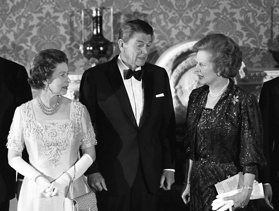 The Queen with then American President Ronald Reagan and then Prime Minister Margaret Thatcher. Mrs Thatcher was Britain's first female PM, and while she and the Queen reportedly had a complicated relationship, she holds the longest leadership tenure in her reign. [Photo: PA]