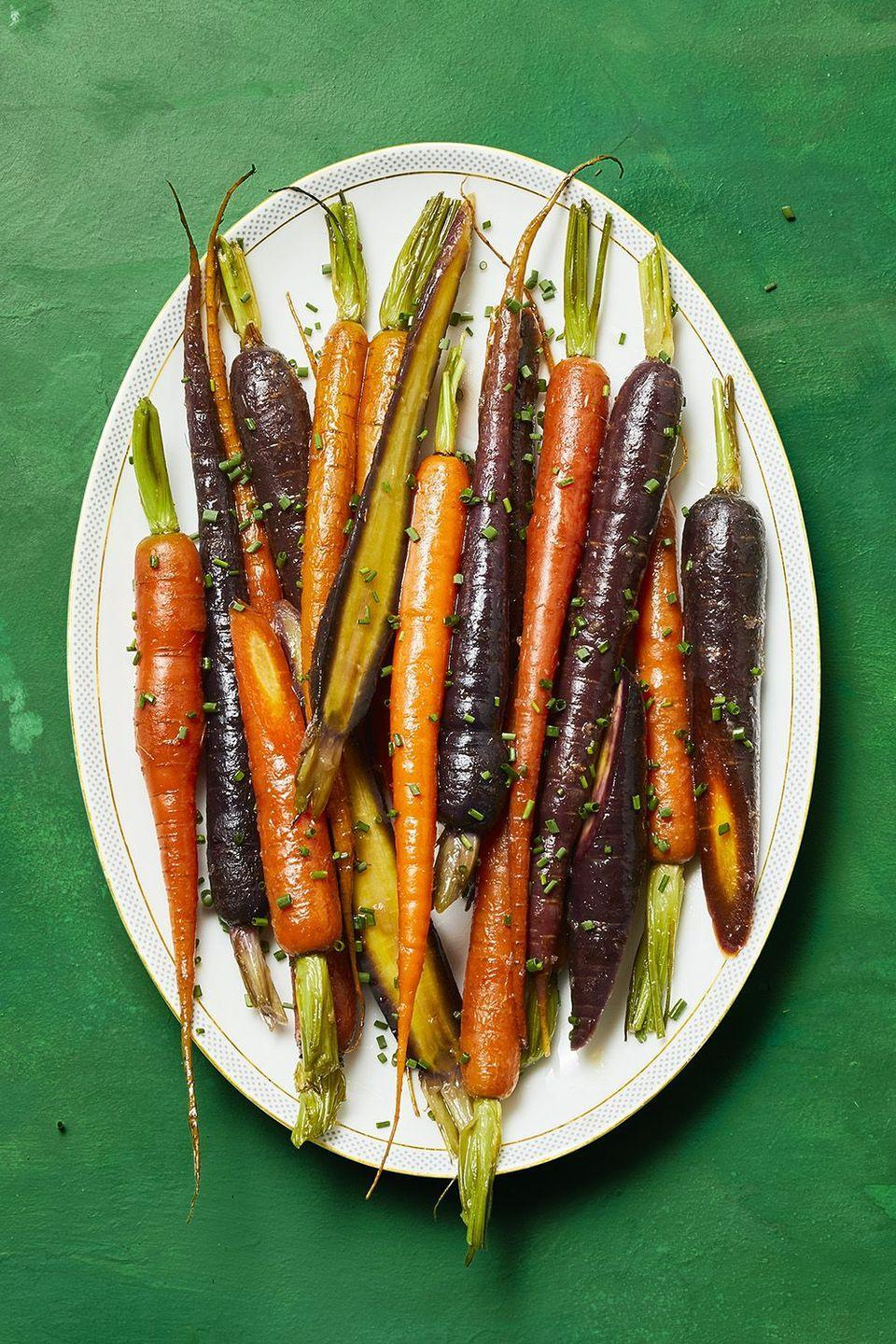 """<p>You shouldn't have to spend too much time on making carrots an appealing appetizer. That's why these honey glazed carrots give you the best of both the sweet and spicy worlds, and only take 20 minutes to make. </p><p><a href=""""https://www.womansday.com/food-recipes/a34146536/honey-glazed-carrots-recipe/"""" rel=""""nofollow noopener"""" target=""""_blank"""" data-ylk=""""slk:Get the recipe for Honey Glazed Carrots."""" class=""""link rapid-noclick-resp""""><strong><em>Get the recipe for Honey Glazed Carrots.</em></strong></a></p>"""