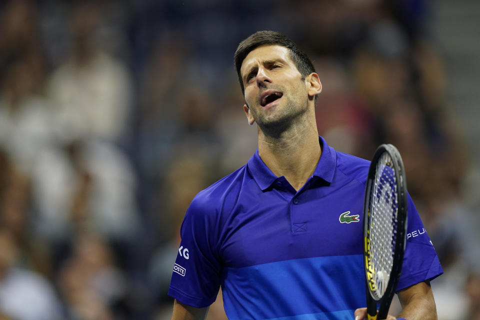 Novak Djokovic, of Serbia, reacts after missing a shot against Tallon Griekspoor, of the Netherlands, during the second round of the US Open tennis championships, Thursday, Sept. 2, 2021, in New York. (AP Photo/Frank Franklin II)