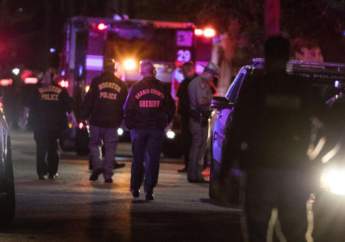FILE - In this Monday, Jan. 28, 2019, file photo, police investigate the scene where several Houston Police officers were shot in Houston. A woman was sentenced on Tuesday, June 8, 2021, to three years and four months in federal prison for making false 911 calls that ultimately resulted in the 2019 drug raid by Houston police that killed both homeowners. Patricia Garcia was the first person to be sentenced in connection with the deadly raid in which Dennis Tuttle, 59, and his wife, Rhogena Nicholas, 58, were fatally shot on Jan. 28, 2019. (Brett Coomer/Houston Chronicle via AP, File)