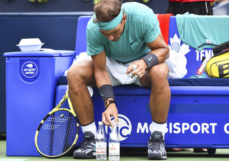 Rafael Nadal, pictured here obsessing about his water bottles in 2019.