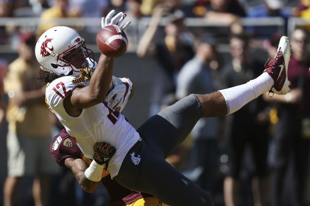 Washington State wide receiver Dezmon Patmon (12) has a passed intended for him broken up by Arizona State safety Cam Phillips, back left, during the first half of an NCAA college football game Saturday, Oct. 12, 2019, in Tempe, Ariz. (AP Photo/Ross D. Franklin)