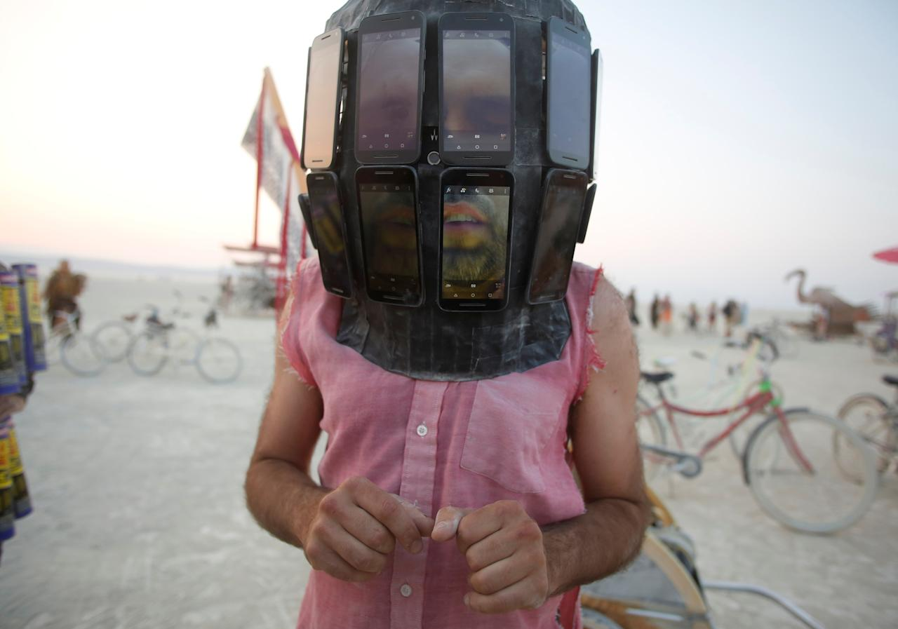 <p>Derek Schoonmaker walks on the playa with his helmet made of android phones as approximately 70,000 people from all over the world gathered for the annual Burning Man arts and music festival in the Black Rock Desert of Nevada, Sept. 1, 2017. (Photo: Jim Urquhart/Reuters) </p>