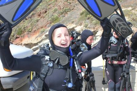 March 16, 2013.  Meghan Heneghan, Richelle Tanner, and Kristen Weiss (left to right) prepare for their first scuba dive.   Photo by the author.