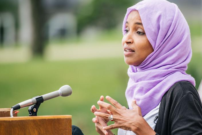Rep. Ilhan Omar (D-Minn.) speaks at a press conference in St. Paul, Minnesota, on Tuesday. Her outspoken progressive style has won her both passionate supporters and enemies. (Photo: Brandon Bell/Getty Images)