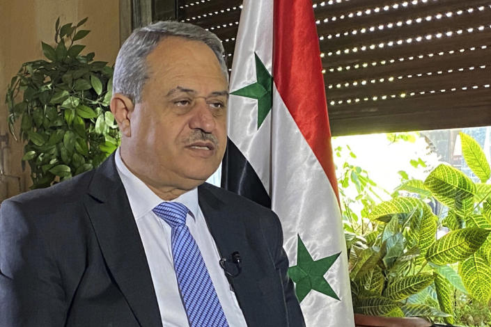 Syrian presidential candidate Mohamoud Marei, 67, a trained lawyer, speaks during an interview with The Associated Press in Damascus , Syria, Tuesday, May 18, 2021. Marei who heads a small government-sanctioned opposition group, has little chance of waging real competition in next week's election to the incumbent Assad, who took office in 2000 after his father's death. (AP Photo)