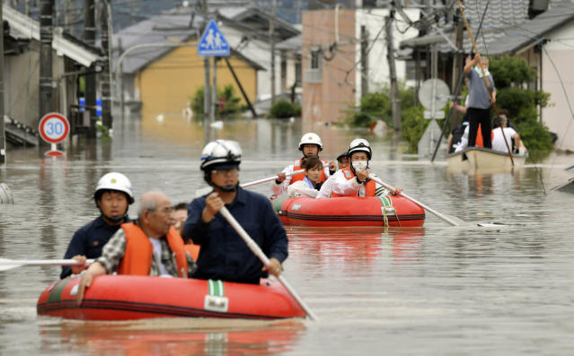 <p>Residents are rescued by boat in Kurashiki, Okayama prefecture, western Japan Saturday, July 7, 2018. (Photo: Kyodo News via AP) </p>