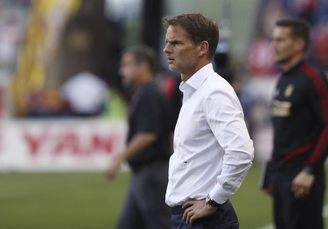 "FILE - In this May 19, 2019, file photo, Atlanta United coach Frank de Boer watches during the second half of the team's MLS soccer match against the New York Red Bulls in Harrison, N.J. De Boer said he regrets his choice of words in a British newspaper interview about gender equity in soccer and stressed that he's a big supporter of the women's game. De Boer faced backlash before Wednesday's Campeones Cup game for his comments in an article published by The Guardian, in which he said it was ""ridiculous"" that female players expect to receive the same World Cup pay as the men. (AP Photo/Steve Luciano, File)"