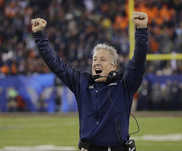 Seattle Seahawks head coach Pete Carroll reacts as Percy Harvin returns a kickoff for a touchdown during the second half of the NFL Super Bowl XLVIII football game against the Denver Broncos Sunday, Feb. 2, 2014, in East Rutherford, N.J. (AP Photo/Matt Slocum)