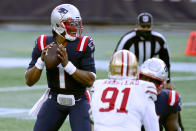 New England Patriots quarterback Cam Newton drops back to pass under pressure from San Francisco 49ers defensive end Arik Armstead (91) in the first half of an NFL football game, Sunday, Oct. 25, 2020, in Foxborough, Mass. (AP Photo/Charles Krupa)