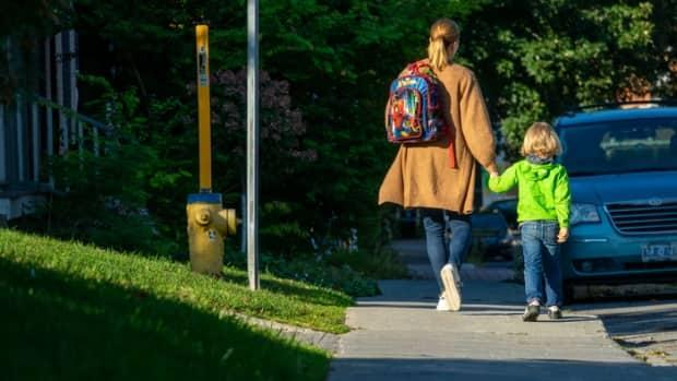 A family walks to school in Ottawa on Sept. 13, 2021, during the COVID-19 pandemic.  (Francis Ferland/CBC - image credit)