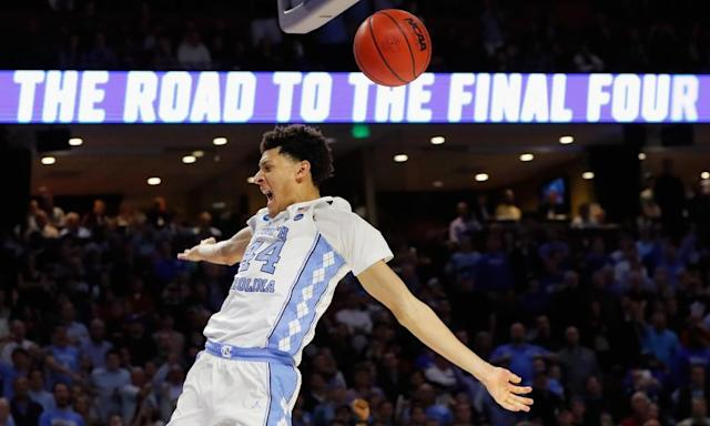 "<span class=""element-image__caption"">North Carolina's Justin Jackson dunks the ball to punctuate the Tar Heels' second-round win over Arkansas.</span> <span class=""element-image__credit"">Photograph: Kevin C Cox/Getty Images</span>"